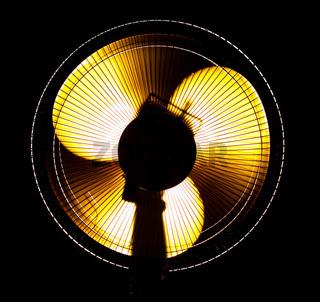 big office fan in yellow light