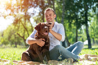 Young man with a dog in the park