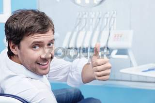 Attractive man in a the dental chair