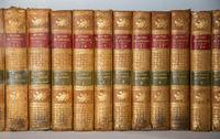 Tsarskoye Selo (Pushkin), Saint-Petersburg, Russia - March, 27, 2021: Old books on bookshelf of Tsarskoye Selo Lyceum. A row of dusty and worn education books
