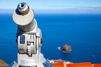 Tourist telescope at viewing point by the sea