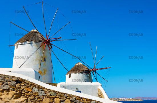 Old white windmills by the sea in Mykonos