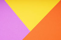 colorful paper background with triangle pattern in pink yellow and orange