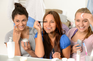 Three teenager girls getting ready in bathroom