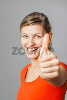 young woman thumb up