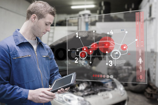 Mechanic using tablet and futuristic interface