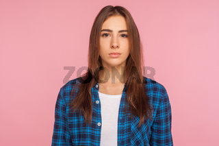 Portrait of young emotional woman on pink background.
