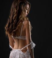 Sensual woman in white lingerie in studio