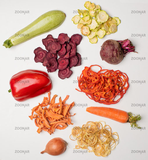 The slices of various dried vegetables as a snack for vegetarians