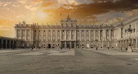 The Royal Palace of Madrid building against sunset. Spain