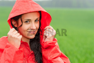 Adolescent girl in the rain in cloak
