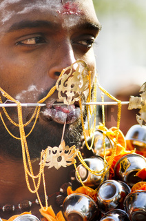 Kavadi carrier with piercing on face, thaipusam malaysia