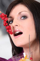 Woman eating redcurrant berries