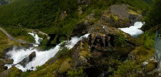 Panoramic view to kleivafossen waterfall at briksdalselva river, Briksdalsbreen glacier, Norway