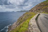 Narrow winding road on edge of cliff, Wild Atlantic Way of Dingle peninsula