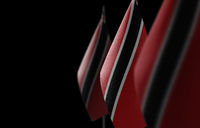 Small national flags of the Trinidad and Tobago on a black background