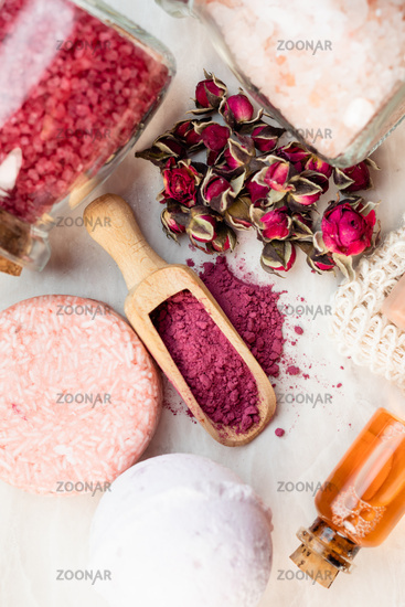 Homemade organic cosmetic with dry rose buds.