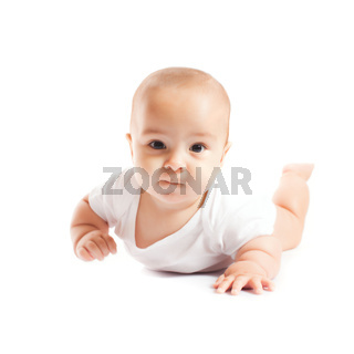 Funny baby lying on the stomach and looking