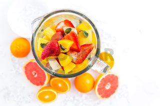 Variation of fruits in mixer. Preparing milkshake or smoothie