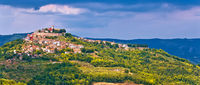 Historic town of Motovun on green hill panoramic view