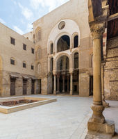 Main courtyard of Mamluk era public historic mosque of Sultan Qalawun with stone column in the front, Cairo, Egypt