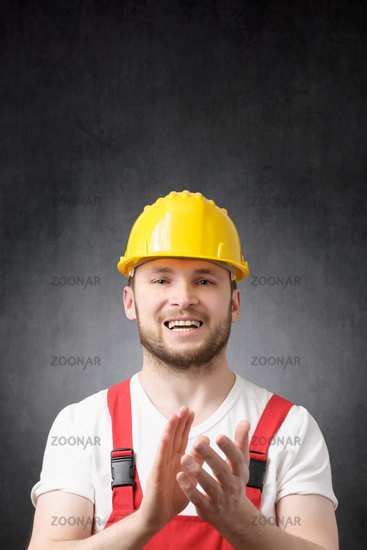 Portrait of a construction worker clapping his hands