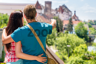 Young man showing woman the castle architecture