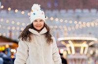 happy little girl over christmas market lights