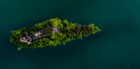 Island on Lauerzersee in Switzerland. Lake in the Swiss Alps.