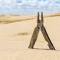 Pasatizh in the sand. tool is a lot functional. Lineman's pliers