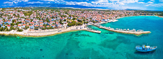 Town of Novalja beach and waterfront on Pag island aerial panoramic view