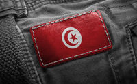 Tag on dark clothing in the form of the flag of the Tunisia