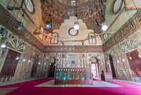 Mausoleum at Mamluk era Mosque and Madrasa of Sultan Hassan with colorful marble mosaic, and carved inscription, Cairo