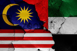 flags of Malaysia and UAE painted on cracked wall