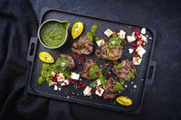Traditional barbecue T-Bone lamb steaks with Greek feta cheese