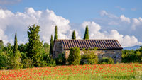 VAL D'ORCIA TUSCANY, ITALY - MAY 19 : Poppy field and old farmhouse in Tuscany on May 19, 2013