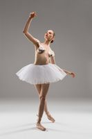 Woman with sticky tapes on breast and ballet tutu