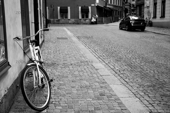 Street and bicycle by the wall in the Old Town of Stockholm