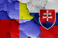 flags of Nitra Region and Slovakia painted on cracked wall