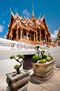 Grand Royal Palace with bonsai tree garden. Wat Phrasrirattana Sasadaram and Wat Phra Kaew, Bangkok City, Thailand