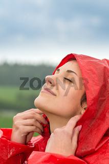 Portrait of young girl feeling the rain