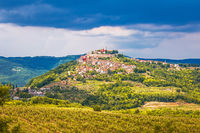 Historic town of Motovun on green hill view