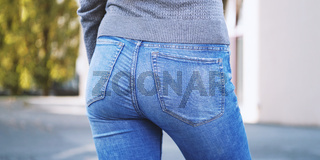 close-up of female butt wearing jeans outside