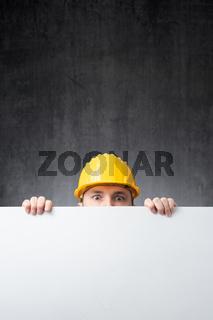 Worker holding a blank board