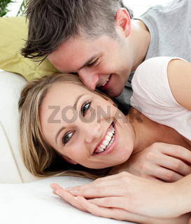 United lovers having fun together on a sofa
