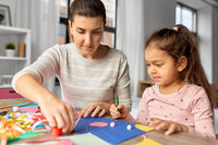 daughter with mother making applique at home