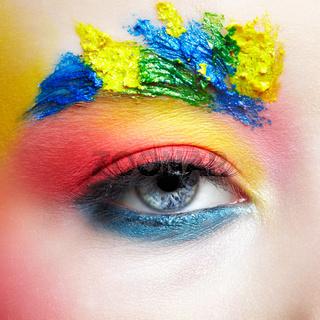 Close-up macro shot of teenager girl eye with unusual art make-up.