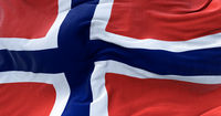 Detail of the national flag of Norway flying in the wind.