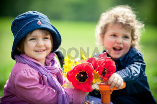 boy and girl in park with toy car