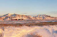 A Farm in Front of the volcano eyjafjallajökull, Iceland, Europe in Winter